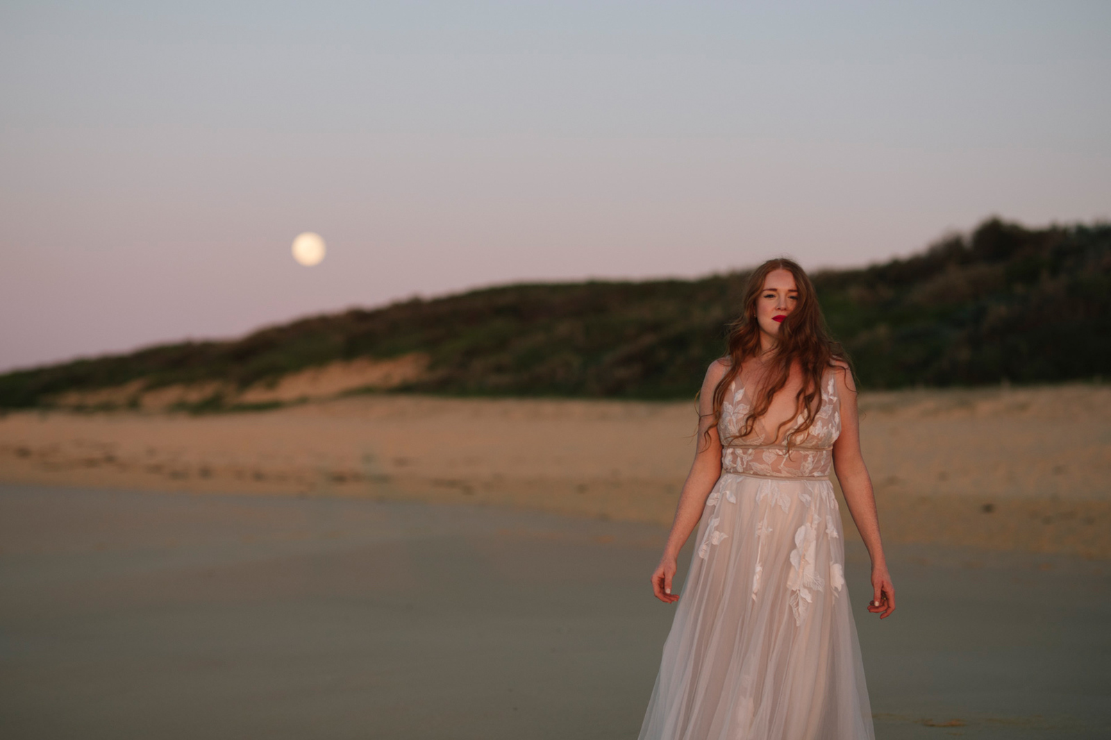 bridal portrait at sunrise with moon in the background
